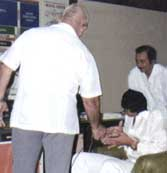 Jose Silva in his laboratory conducting research with famed holistic faith healer Ivan the Magnificent